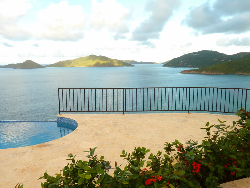Ixora flowers divide the two-tiered pool deck at AnaCapri Estate - down island view all of the way to Virgin Gorda