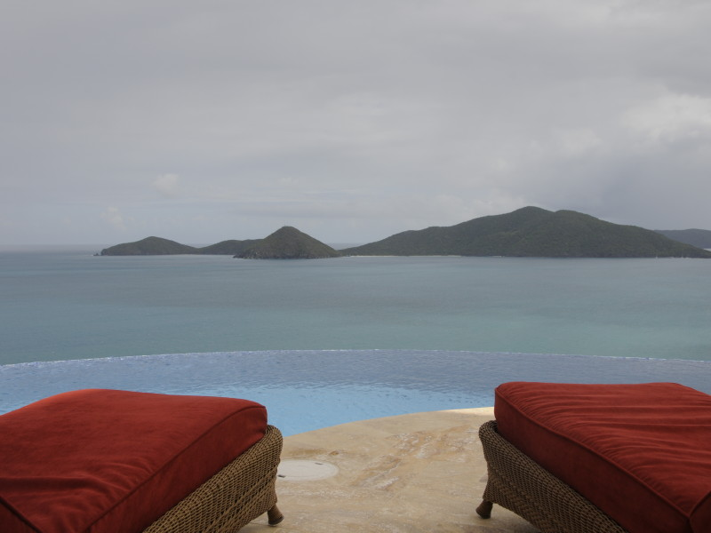 Guana Island, BVI - AnaCapri Estate's infinity pool flows into Cooten Bay and overlooks Guana Island