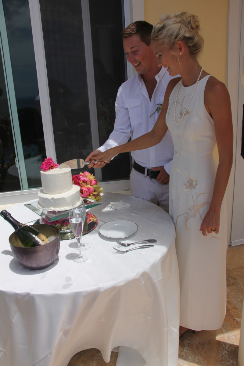 The bride and groom cutting the Chocolate Cake made with Bailey's Irish Cream