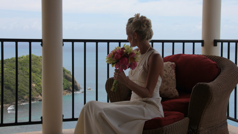 Caribbean destination wedding - bride on Master Bedroom porch overlooking Rogue's Point