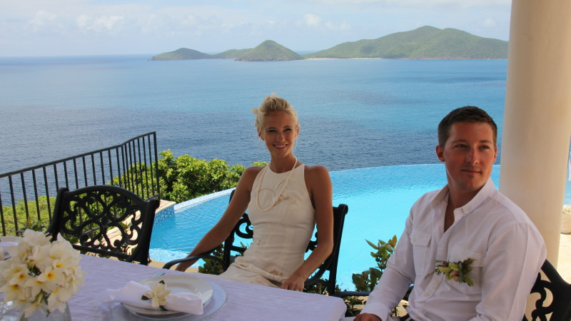 Wedding couple relaxing by the Infinity edge pool at AnaCapri Estate